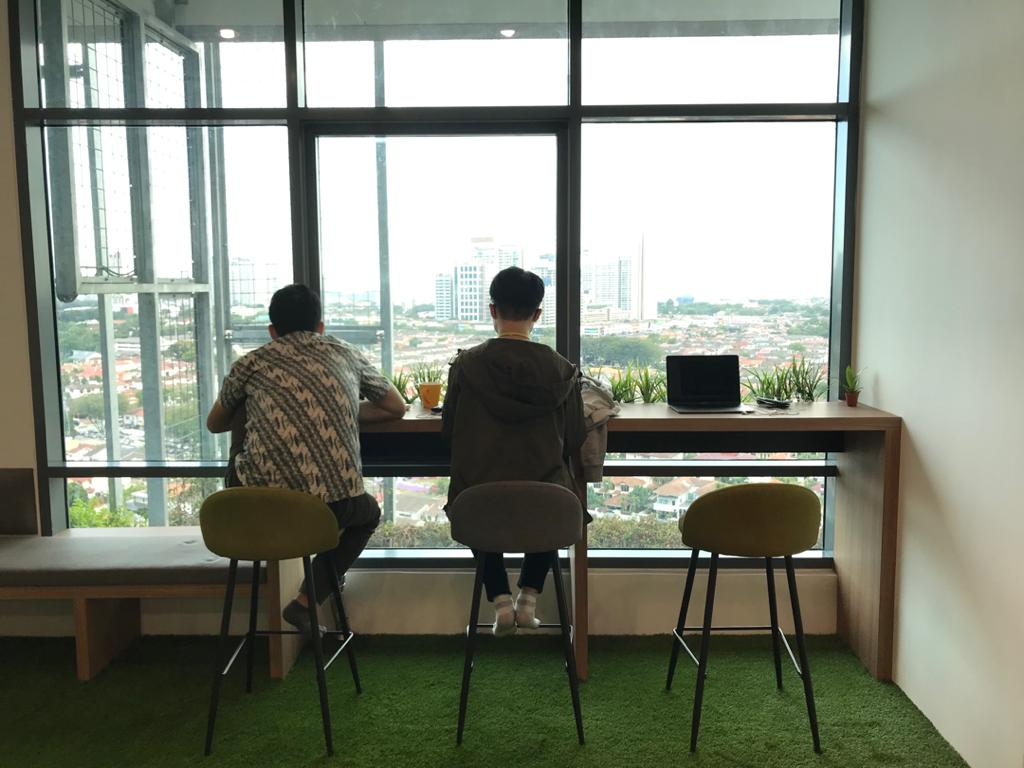 two guys working casually at chillout area