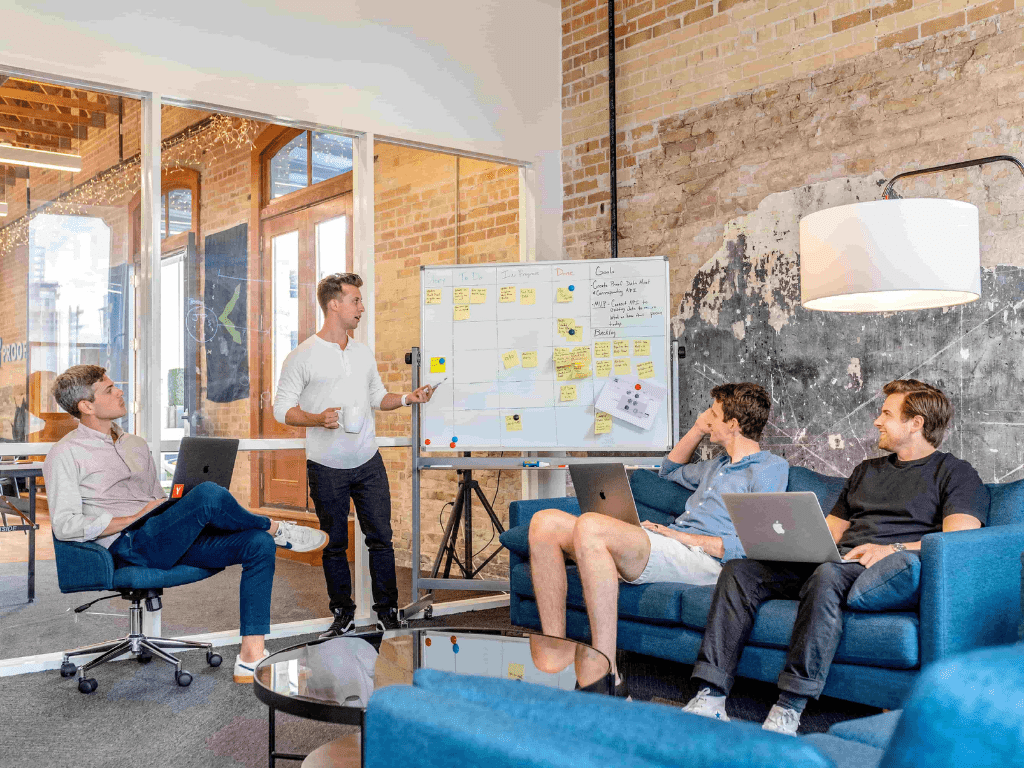 startup team discussing strategy in a room
